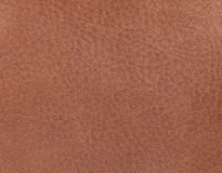 Light brown leather background from a textile material. Fabric with natural texture. Backdrop. Light brown leather background from a textile material. Fabric royalty free stock photos