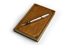Light brown leather journal with the posted golden fountain pen over the book cover stock photography