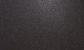 Light brown leather texture, with a pattern of figures of irregular shape. Leather texture Stock Image