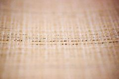 Light brown linen fabric texture surface closeup as textile background stock photo