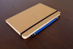 light brown notepad book and pencil Royalty Free Stock Photography