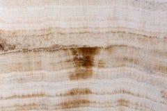 Light brown onyx stone texture on macro. stock photography