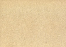 Light brown paperboard surface background Stock Images
