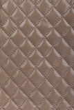 Light brown quilted leather background Royalty Free Stock Photos