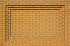 Light brown rectangular concave brick wall background Royalty Free Stock Photos