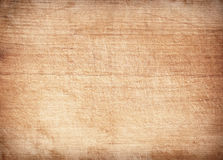 Light brown scratched wooden cutting board. Wood texture.  stock photos