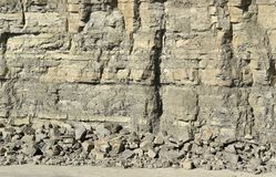 Light brown stone pit wall Royalty Free Stock Photos