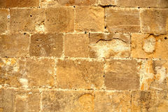 Light brown stone wall royalty free stock photos