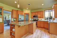 Light brown storage combination in large kitchen room Stock Photos
