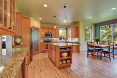 Light brown storage combination in large kitchen room Stock Photo