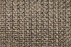 Light brown textile background with checkered pattern, closeup. Structure of the fabric macro. Royalty Free Stock Photo
