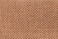 Light brown textile background with checkered pattern, closeup. Structure of the fabric macro. Royalty Free Stock Photos