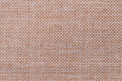 Light brown textile background closeup. Structure of the fabric macro stock images