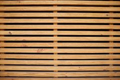 Light brown vintage horizontal wood planks background in a black lines. Stock Images