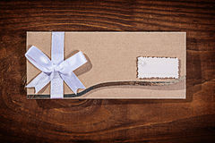 Light brown wedding invitation envelope on old wooden board Stock Images