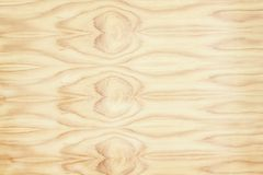 Light brown wood grain texture. natural wave patterns in horizontal abstract background royalty free stock image