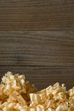Light brown wood shavings from carpenter`s hand planer or chisel. Work on wooden boards background with copy space Royalty Free Stock Photography