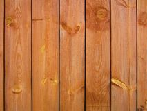 Light brown wooden boards. The shield is made of beautiful wooden slats with knots. Royalty Free Stock Photos
