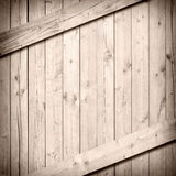 Light brown wooden wall or floor surface with vertical and diagonal planks Stock Photography