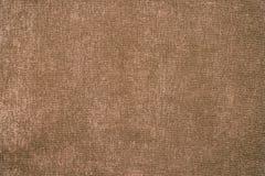Light brown wool velvet texture background. Brown velvet fabric stock photo