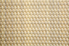 Light brown woven plastic background Royalty Free Stock Image