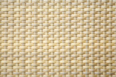 Light brown woven plastic background Royalty Free Stock Photo