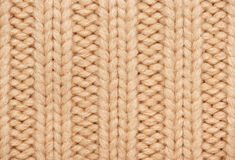 Light brown and yellow knitted wool macro photo, texture background Stock Photography