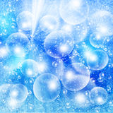 Light bubbles on a blue grunge Royalty Free Stock Photo