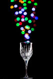 Light bubbles coming out of a wine glass Royalty Free Stock Photos