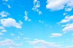 Light bue sky with white clouds. May be used as background royalty free stock photography