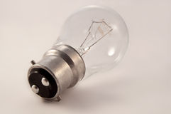 Light bulb. Close on an isolated clear glass light bulb arranged over light grey Stock Images