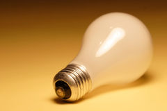Light Bulb. On yellow background Royalty Free Stock Photography