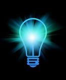 Light bulb. Abstract light bulb with beams on black Stock Image