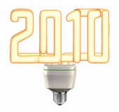 Light bulb 2010 - saving energy. Fluorescent light bulb isolated on a white background Stock Images