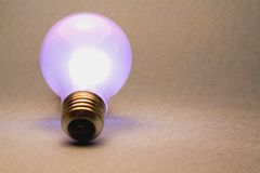 Light Bulb. A shot of a glowing light bulb Royalty Free Stock Photo