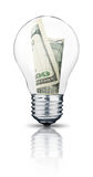 Light bulb. With Dollars banknote in it Stock Images