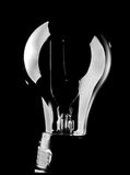 Light Bulb. Lit from outside using softbox, black background Royalty Free Stock Images