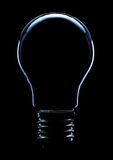 Light bulb. On black background with copy space Royalty Free Stock Images