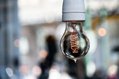 Light bulb. A light bulb hanging from the selling Royalty Free Stock Photo