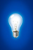 Light bulb. Light bulb on blue background Stock Photo