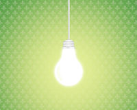 Light bulb. With a green retro background Stock Image