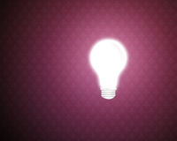 Light bulb. With a purple retro background Royalty Free Stock Images