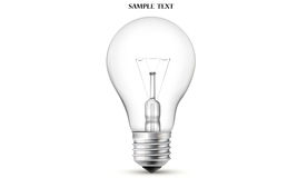 Light bulb. With filament showing isolated on white background Stock Image