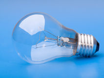 Light bulb. In blue background royalty free stock image
