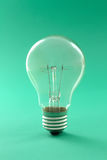 Light bulb. On a green background Stock Photo