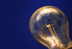 Light bulb. On blue Royalty Free Stock Photos