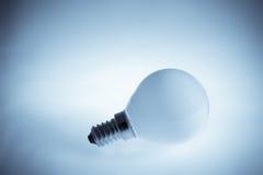 Light bulb. Single light bulb on the white background Stock Photo