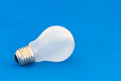 Light bulb. A light bulb on a blue background Royalty Free Stock Photos
