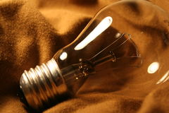 Light bulb. In brown mood stock photos