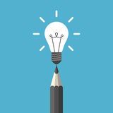 Light bulb above pencil Royalty Free Stock Photo